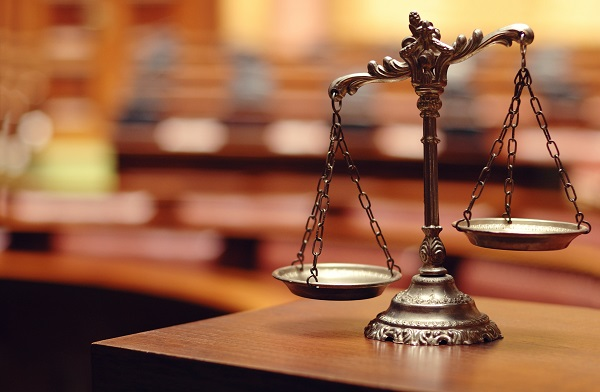 NH law firm scales of justice